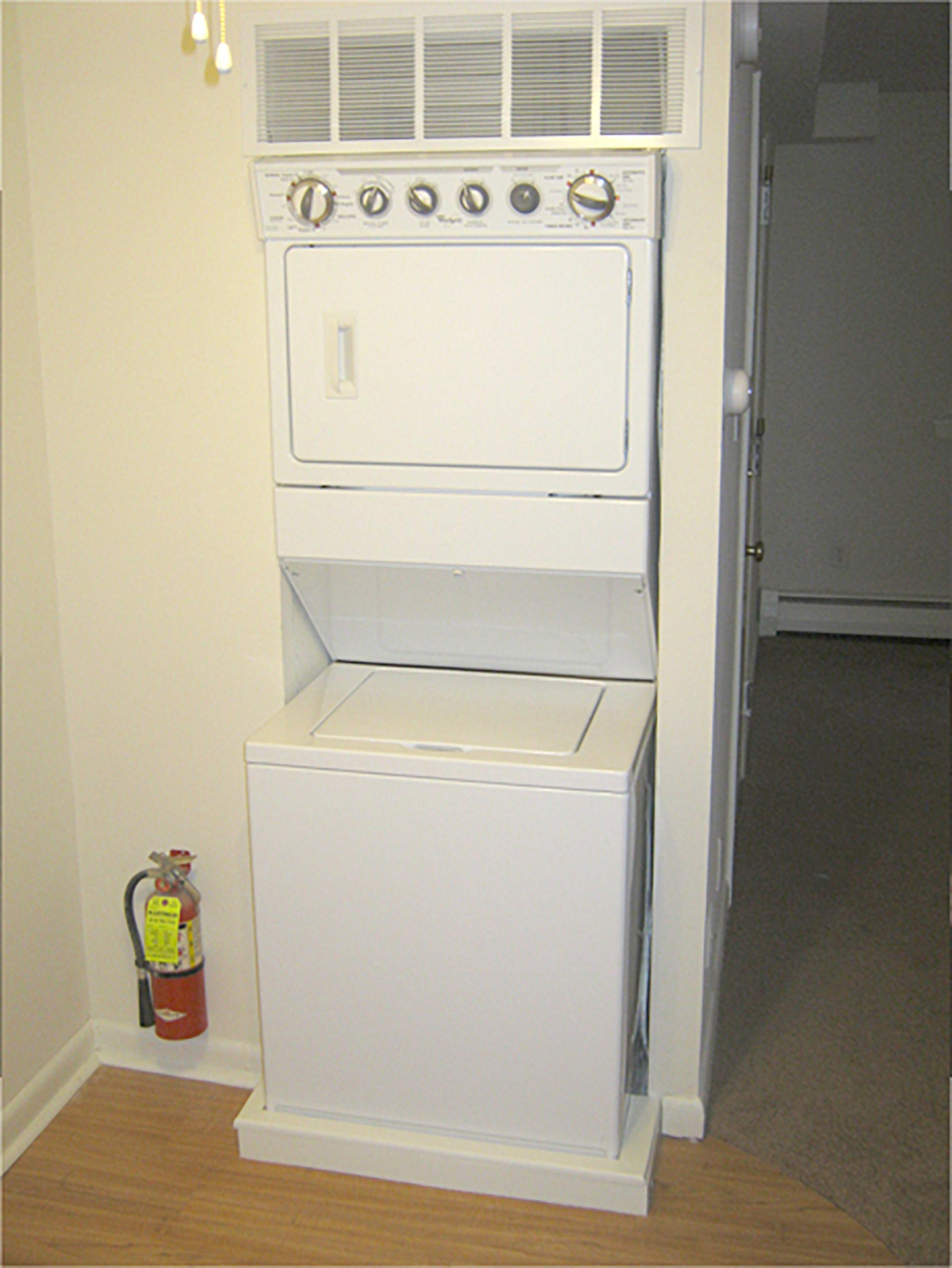 Ardmore Court interior stacked washer and dryer